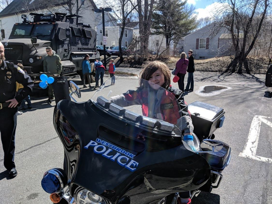 Child on our motorcycle at an open house