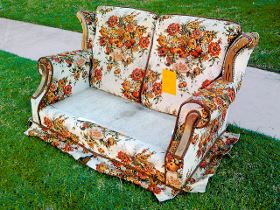 Floral couch sitting on the curb for bulky waste pick up